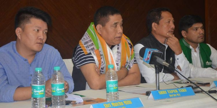 Tapuk Taku (centre) speaking to reporters in Itanagar on Tuesday.