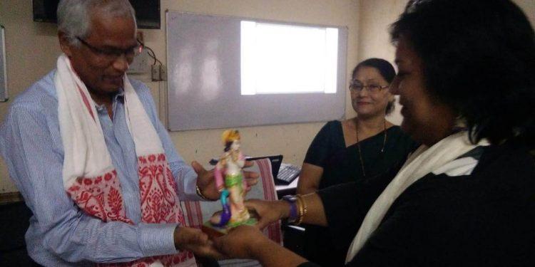 Assam Women's University academic registrar LK Hazarika being felicitated in Jorhat on Saturday.