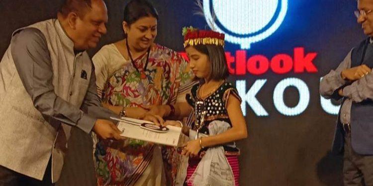 Union minister of women and child development Smriti Zubin Irani gives away the award to the Valentina Elangbam.