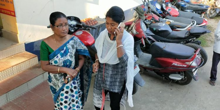 Digboi woman with her daughter at police station. Image: Northeast Now