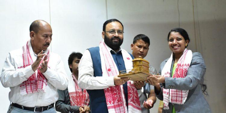 Sivasagar deputy commissioner Dr M S Lakshmi Priya felicitating Assam minister Keshab Mahanta at the national seminar on November 20, 2019. Image: Northeast Now