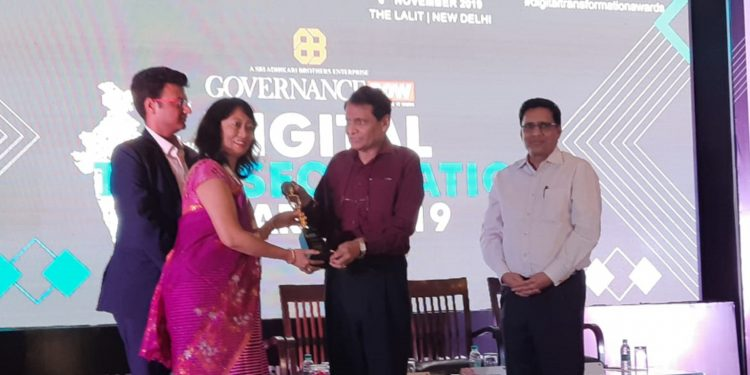 Bishnupur DC Neeta Arambam receiving the award