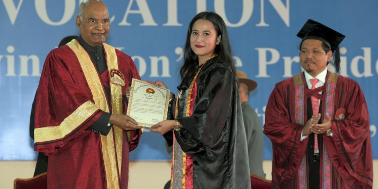 President Ram Nath Kovind conferring award to a student at the 26th Convocation of NEHU in Shillong on Monday.