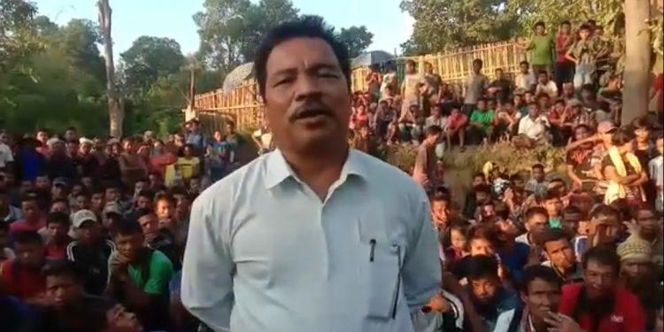 Tripura MLA Prem Kumar Reang in front of a Bru refugee camp. Image: Northeast Now