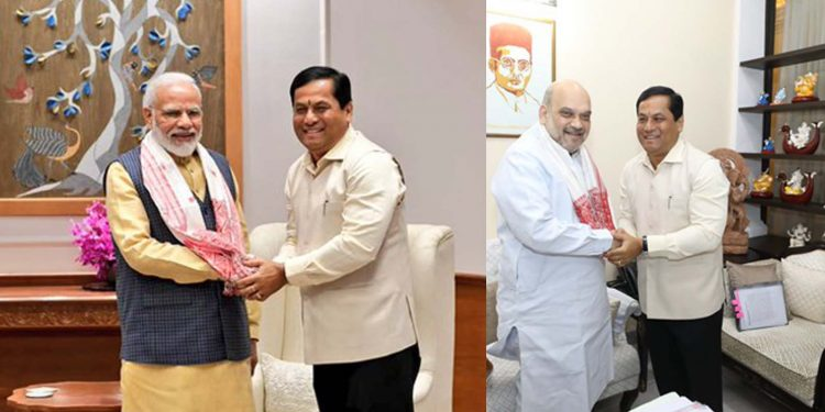Sonowal with Modi and Shah