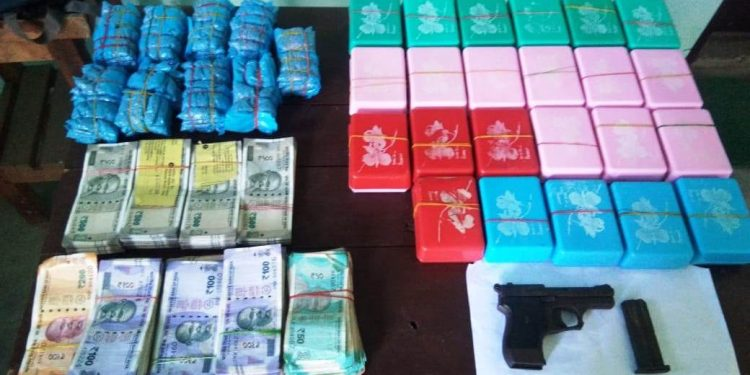The seized drugs, cash  and other items.