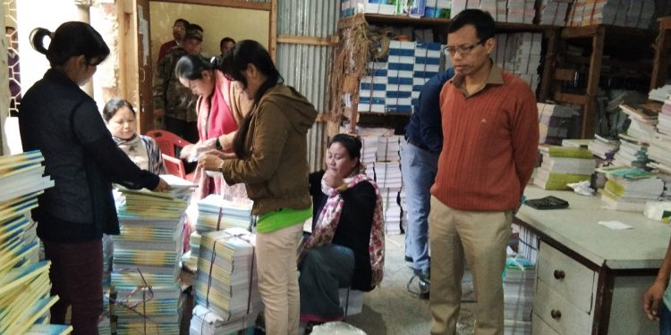 Chairman of Board of Secondary Education, Manipur, Th Kiran Kumar inspecting the textbooks preparations. Image: DIPR, Manipur