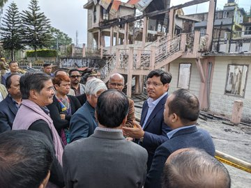 Meghalaya chief minister Conrad Sangma at the site of the church which was gutted. Image courtesy: Twitter @SangmaConrad