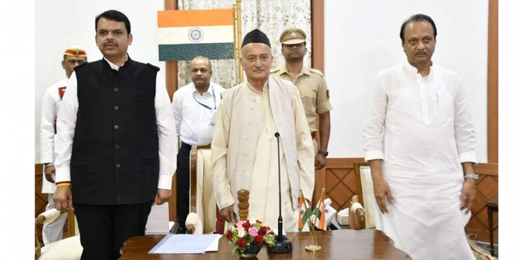 Devendra Fadnavis (left) along with Ajit Pawar (right) after taking oath with Maharashtra Governor Bhagat Singh Koshyari (middle). Image credit: Twitter