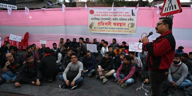 Members of AASU and photographers stage sit-in protest in Jorhat on Saturday. Image credit: Pranjyoti Nath