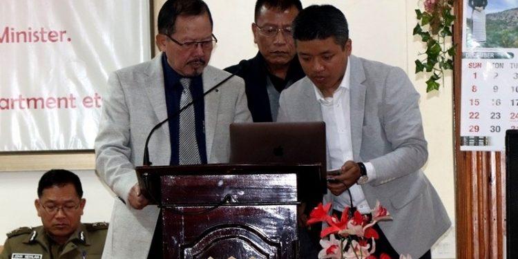 Home minister Lalchamliana (left) launches ILP portal in Aizawl on Monday.