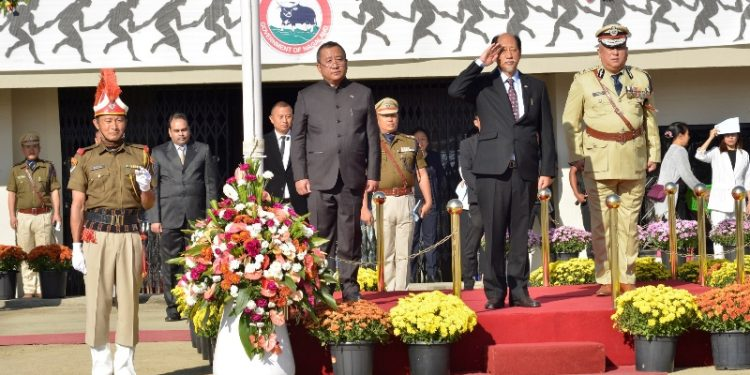 Nagaland chief minister Neiphiu Rio taking the salute from parade contingents during the 57th Statehood Day celebration in Kohima on Sunday.