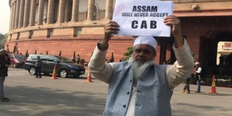 AIUDF chief Badruddin Ajmal held up placards saying that the bill was against the idea of India.