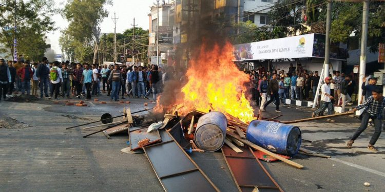 Protesters burnt tyres on Wednesday afternoon protesting against CAB in Guwahati. Image: Northeast Now
