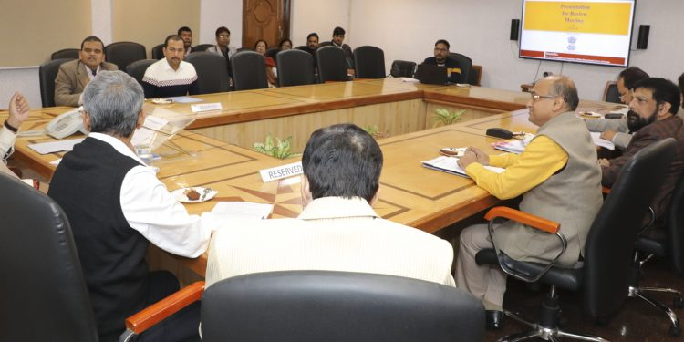 Assam CM Sarbananda Sonowal in discussion with food and civil supplies department officials.
