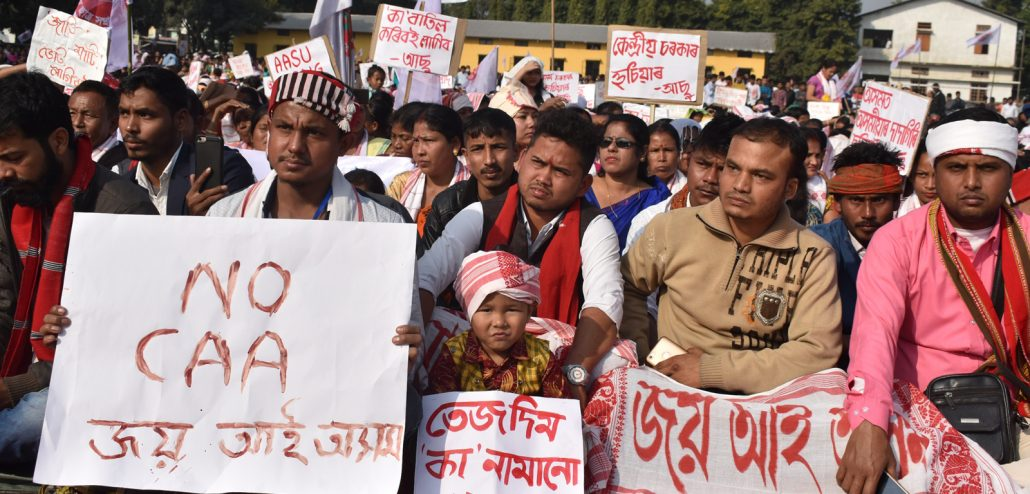 Protesters holding placard in Tangla during anti-CAA protest. Image: Northeast Now