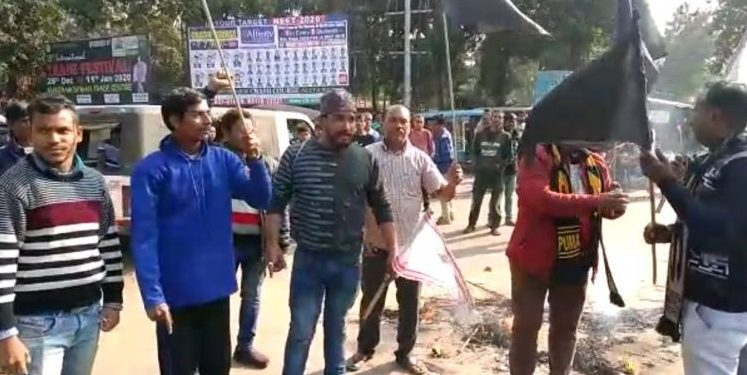 AJYCP activists burn effigies of Prime Minister Narendra Modi and home minister Amit Shah in Guwahati.