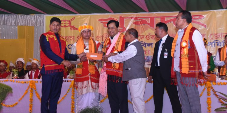 Assam chief minister Sarbananda Sonowal presenting government allowance to Gobha Rajas at the historic Jonbeel Mela in Marigaon district on January 18, 2020. Handout image