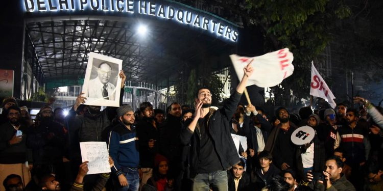 JNU students protest at Delhi Police Headquarters after some masked miscreants attacked students and faculty on the JNU campus New Delhi on Sunday.