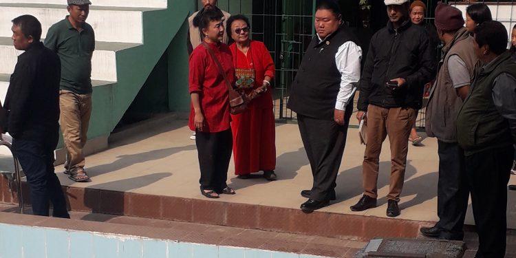Nagaland minister Temjen Imna Along (in black waist coat) inpecting the swmming pool on Sunday.