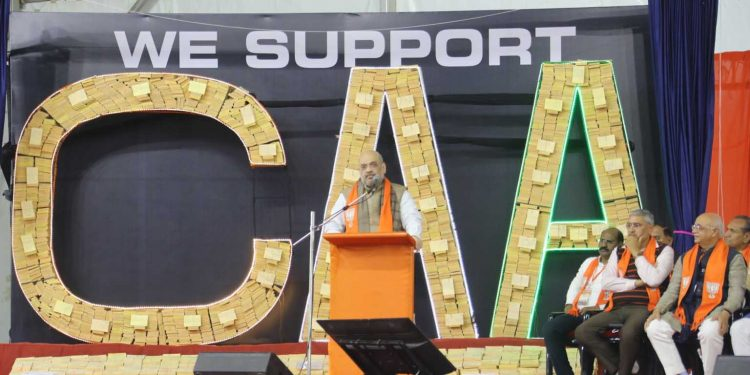 """Amit Shah unveiling """"We Support CAA"""" post cards"""