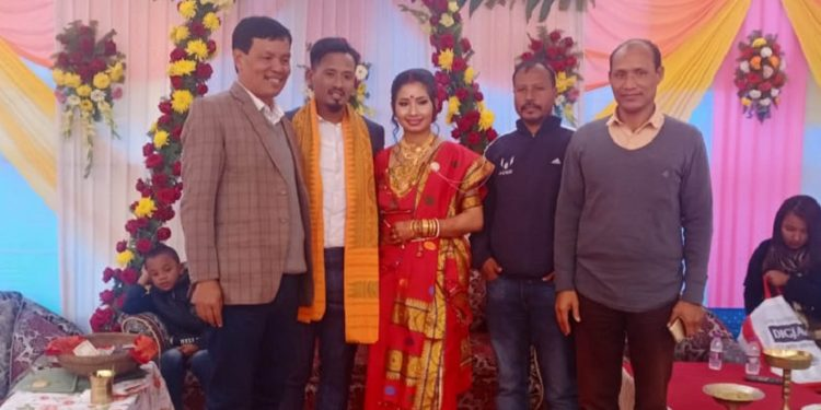Durga Boro (second from left) with his wife and some other guests.
