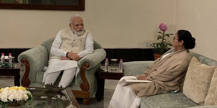 PM Narendra Modi with West Bengal CM Mamata Banerjee in Kolkata on Saturday