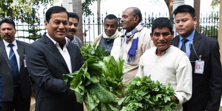 Assam CM Sarbananda Sonowal with farmers from Sonapur