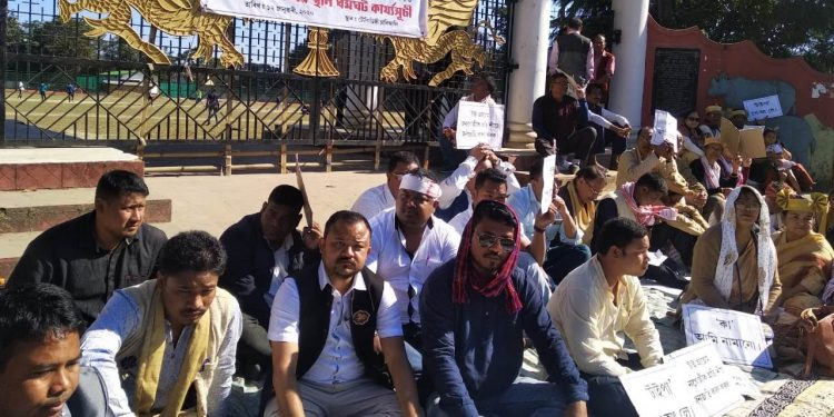 The protesters holding play cards and banners raised slogans against the BJP government.