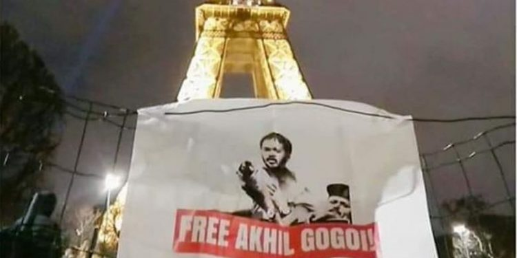 Supporters of KMSS chief Akhil Gogoi have recently put up huge banners in front Eiffel Tower .