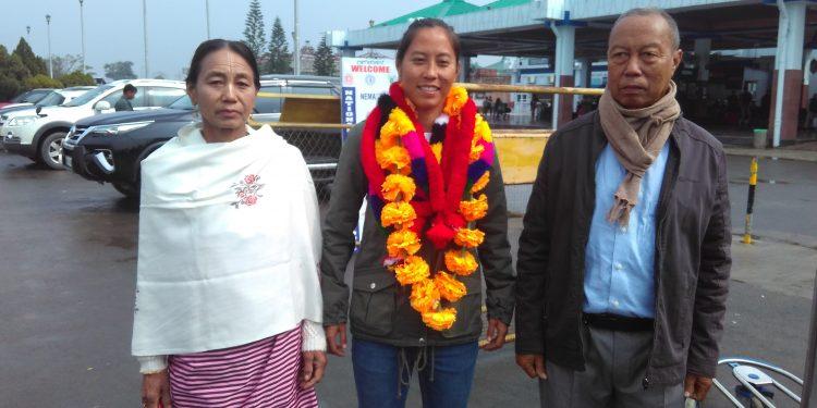 Ngangom Bala Devi with her father, Manihar and mother, Mema at Bir Tikendrajit International Airport in Imphal. Image: Sobhapati Samom