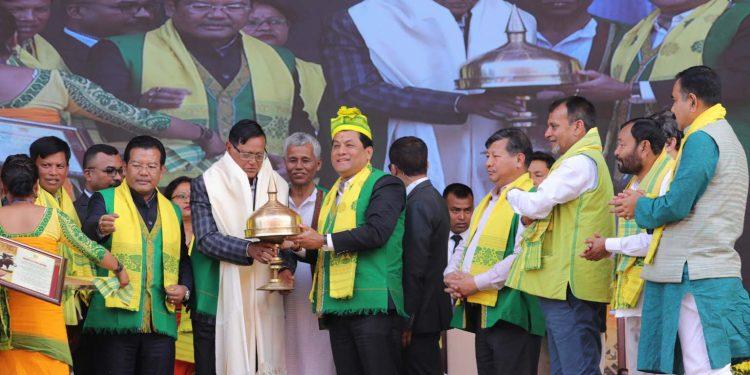 Assam CM Sarbananda Sonowal presenting the Bir Chilarai Award to Bhogeswar Baruah on Sunday.