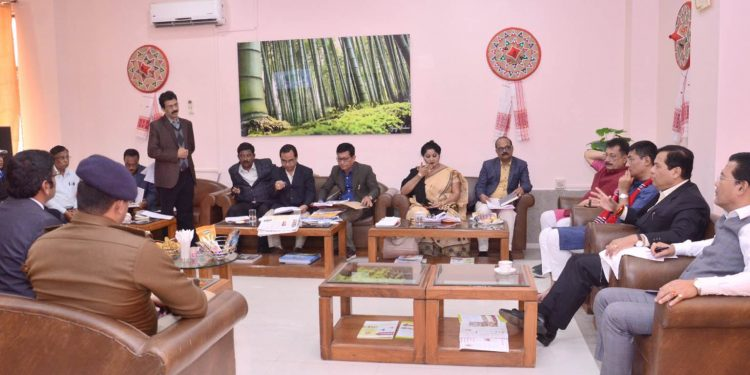 Assam CM Sarbananda Sonowal with others during a review meeting with Lakhimpur DC on Thursday