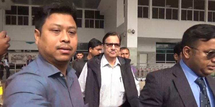Former Tripura CS Yash Pal Singh (wearing spectacles) in Tripura police custody. Image: Northeast Now