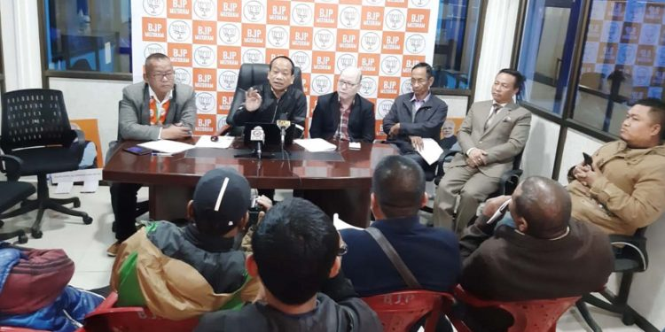 Mizoram BJP president Vanlalhmuaka with other members interacting with media. Image: Northeast Now
