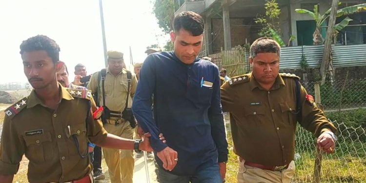 Simanta Kalita, one of the two miscreants who attacked two students in Pathsala, in police custody. Image: Northeast Now