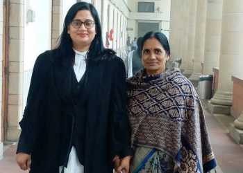 Asha Devi with her lawyer