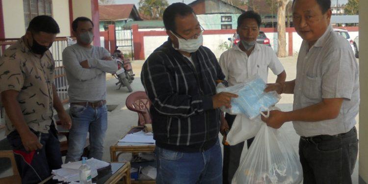 MLA Ninong Ering handed over the medical officer two bundles masks worth Rs 25 thousand.