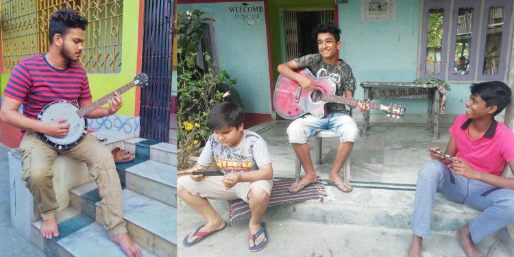 Saurav Sen (left) with his banjo and Abhikesh Sapkota (right) with his guitar during coronavirus lockdown in Udalguri. Image: Northeast Now