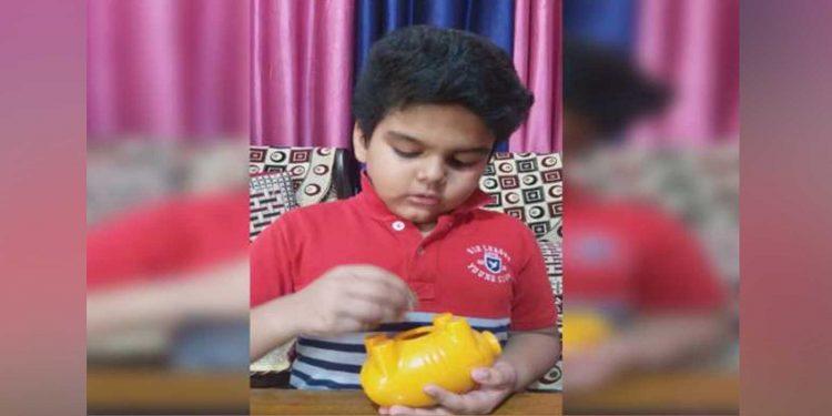 Ayush Das with his piggy bank