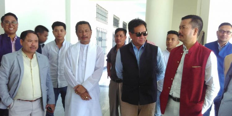 Manipur's titular king Sanajaoba Leishemba (in white) while filing his nomination for RS polls. Image: Northeast Now