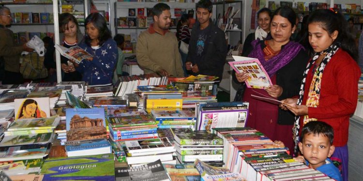 Children browsing through books in a book fair. (File image)