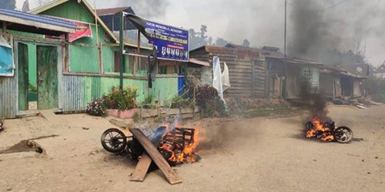 Vehicles were set ablaze in violence. Image credit: Financial Express.