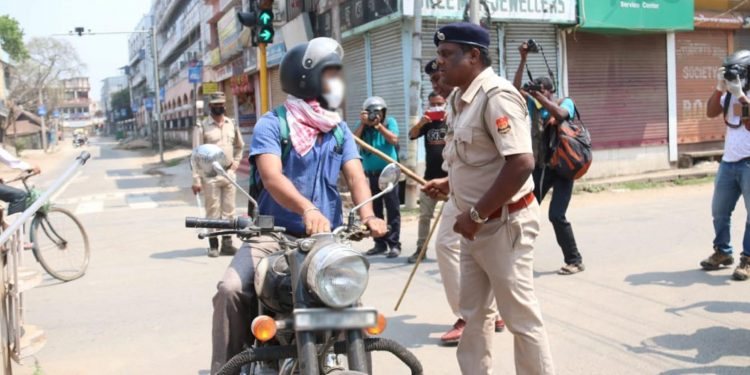 A lockdown violator being questioned by Tripura police personnel in Agartala on Wednesday. Image: Northeast Now