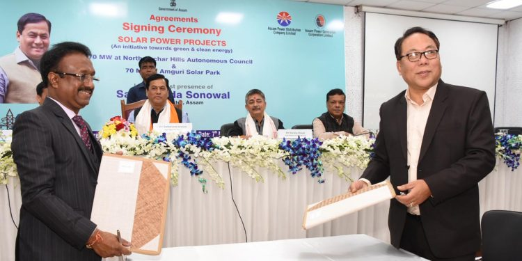 Assam CM Sarbananda Sonowal administering the agreement signing between two solar power projects