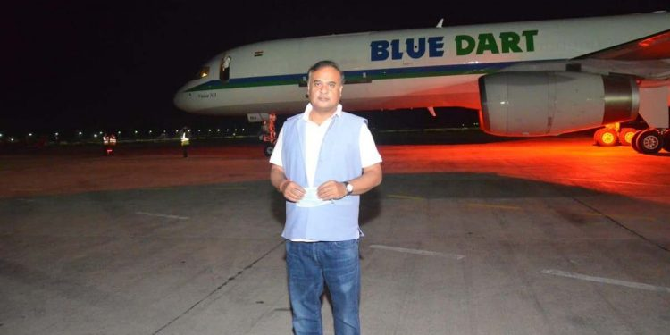 File image of Assam health minister Himanta Biswa Sarma posing before the flight carrying PPE kits and rapid test kits from China.
