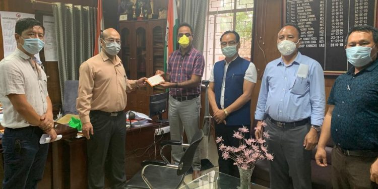 Members of the Federation of Nagaland State Engineering Service Associations handing a cheque of Rs 5 lakh to Dimapur deputy commissioner Anoop Khinchi on Tuesday.