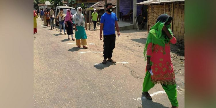People maintaining social distancing while visiting markets in North Lakhimpur. Image: Northeast Now