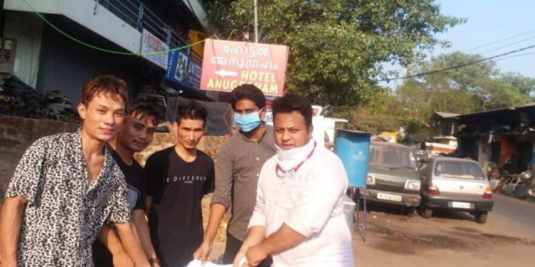 Men from Nagaland being helped by Kerala youth Congress volunteers. Image credit: Northeast Today