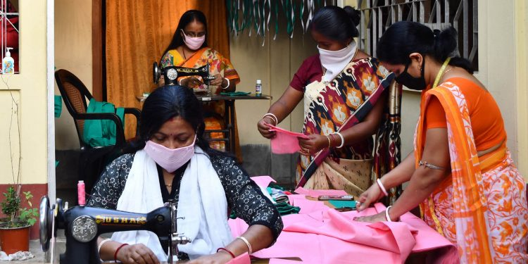 BJP Mahila Morcha workers preparing masks in Tripura. Image: Northeast Now